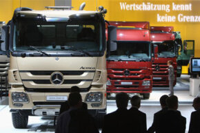 Image Gallery: Trucks Visitors stop to examine Mercedes-Benz heavy trucks at the Daimler stand during a media and industry professionals' day at the IAA Commercial Vehicles trade fair on Sept. 24, 2008 in Hanover, Germany. See more pictures of trucks.