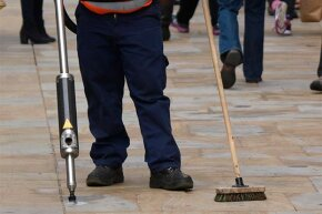 A street cleaner removes gum in Oxford, England. Some municipalities have actually hired professional gum cleaners to get rid of the sticky mess.