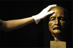 A bust of Max Planck gets a quick dusting. Planck is known as one of the founding fathers of quantum theory.