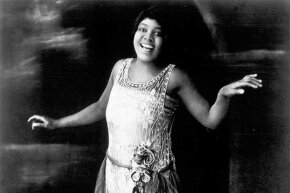 A photo of Bessie Smith singing in her heyday, in the 1920s.
