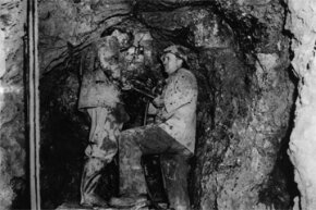 July 1, 1947: Miners search for uranium in the mountains north of Adelaide, Australia.