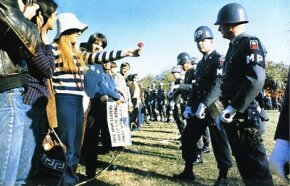 Pacifists and soldiers face off