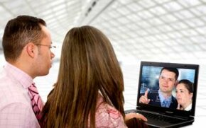 Video conferencing lets associates communicate from different locations.