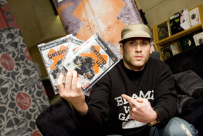 "Designer Mark Ecko holds up his new video game, ""Getting Up."" Careers in video-game design are growing."