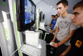 "Video-game testers check out video games before their wide release. Here fairgoers test the new Xbox ""Halo 3."""