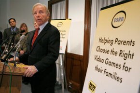 Sen. Lieberman speaks during a news conference with the Entertainment Software Rating Board (ESRB).