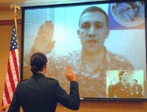 Bridget Kingsley receives the oath of office from her husband 2nd Lieutenant Dan Kingsley in Iraq.