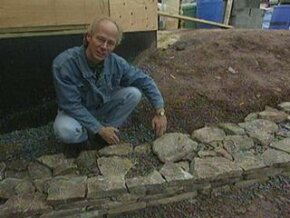 """In this clip from Discovery Channel's """"Gimme Shelter,"""" John Harvey demonstrates how to create a retaining wall."""