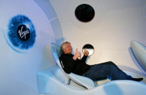 Sir Richard Branson gives a thumbs-up during the unveiling of a scale model of SpaceShipTwo in 2006.