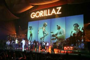 2D, Murdoc Niccals, Russel Hobbs and Noodle of the virtual band Gorillaz perform in 2006 Brit Awards.