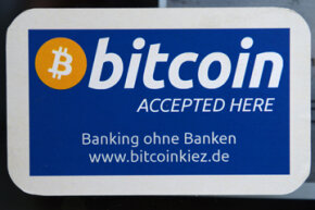 A bar in Berlin posts a sign that it accepts bitcoin. A growing number of businesses (albeit still small) are accepting bitcoin for transactions. See our virtual reality pictures.