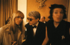 Artist Andy Warhol (center) chats with Nico of The Velvet Underground at a dinner for the New York Society of Clinical Psychiatry in January 1966.