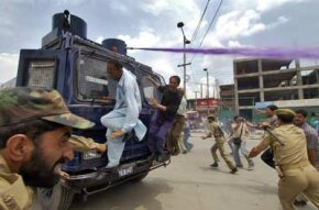 Indian police hose down demonstrators with dyed water cannons. The dye is difficult to wash off, making it easier for police to identify protesters fleeing the scene.