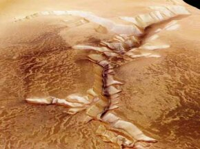 Geographical features such as the Echus Chasam have captured the imaginations of scientists and dreamers for decades. Did Martian water etch these valleys in the planet's surface? See more Mars pictures.