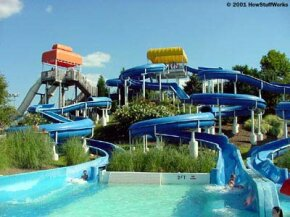In this serpentine water slide, the sharpest curves are completely enclosed, so riders won't go flying off into space.