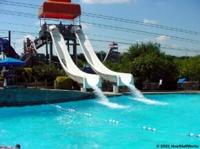 The simplest sort of water slide is a small, curved hill that is lubricated by a stream of water.
