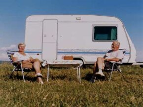 This pleasant couple looks completely unaware of the numerous risks involved in towing their beloved trailer.
