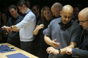Journalists test out the Apple Watch in the Apple Store in Berlin in 2015.