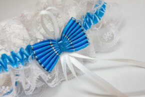 "Many brides like to choose a garter that incorporates ""something blue"" in order to stick to the popular rhyme."