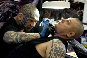 Is this what you'll have to do to get a microphone tattooed on your throat?
