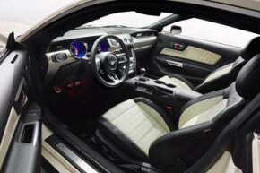 The 2015 Ford Mustang 50-Year Limited Edition interior in Wimbledon White and black leather with contrasting cashmere accents and stitching — and probably a bunch of VOCs, too.