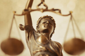 Justice is often depicted as blindfolded and holding scales to weigh each side of an argument.