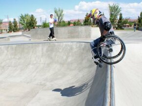 Aaron Fotheringham balances his wheelchair on the lip of a bowl.