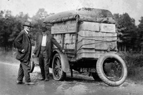 Agents capture a vehicle loaded with liquor as it got a flat tire; The truck is piled high and marked as a taxi.