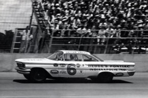 Cotton Owens races by the crowd in his 64' Pontiac. Cotton Owens won the pole for the 500 but had transmission problems on the 149th lap. Owens would take home $200.