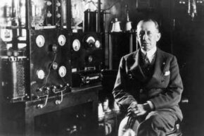 """Italian inventor and radio pioneer Guglielmo Marconi in front of a telegraph in the laboratory aboard his yacht """"Electra"""", circa 1935."""