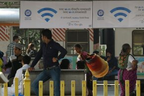 Ads for a free WiFi internet service hang in Mumbai's central railway station.