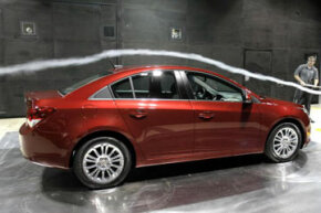 Smoke provides flow visualization so scientists can see how air is moving around the test object.
