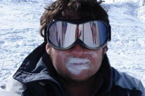 Man with excessive sunblock and large goggles on the slopes. See more pictures of skin problems.