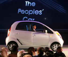 Chairman of the Tata Group, Ratan Tata, drives the new Tata Nano car at the New Delhi Auto Show on Jan. 10, 2008. See more small car pictures.