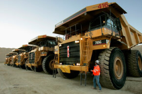 Maintenance foreman Gary Frost inspects huge dump trucks before they start the day at Barrick's Ruby Hill Mine outside Eureka, Nev., in 2006. They're definitely big, but these aren't the biggest mining trucks in use. See more pictures of trucks.