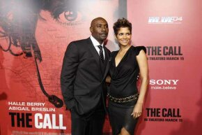 """Halle Berry (R) poses with co-star Morris Chestnut at the premiere of """"The Call,"""" a movie about a 911 dispatcher. See pictures of a day in the life of a police officer."""