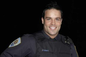 If a cop as cute as this came to your door, you too might be tempted to call 911 to get him to come back.