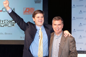 Steve Case, CEO of AOL (L) and Gerald Levin, CEO of Time Warner hug on January 10, 2000 in New York after announcing that AOL was acquiring Time Warner for $166 billion in stock.