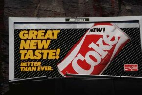 This billboard advertises the short-lived New Coke.