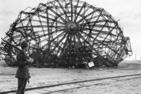 A soldier guarding the remains of the Hindenburg disaster.