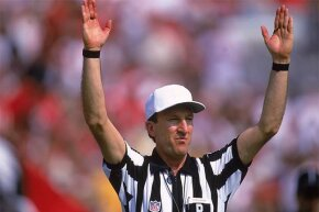 "Referee Phil Luckett signals a score during a game between the Minnesota Vikings and the Tampa Bay Buccaneers in 2000. Back in 1998, he heard the Pittsburgh Steelers co-captain call ""heads"" on a pre-game coin toss. Everyone else heard ""tails."""