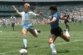 Argentinian forward Diego Maradona (R) readies to cross the ball under pressure from English defender Gary Stevens during the World Cup quarterfinal. This 1986 match is well-remembered for Maradona's 'hand of God' comment.
