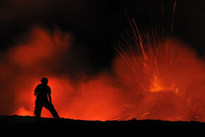 Presumably, she's just watching the lava eruption at Kilauea Volcano on Hawaii's Big Island, not thinking of jumping in.