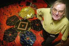 The late Colin Pillinger, lead scientist, posed with a model of Beagle 2 in 2003. The aim of the mission was to look for life on Mars and see how its mountains and rocks formed.