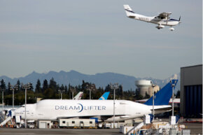 The Boeing 747 Dreamlifter hangs out at Paine Field Airport in Washington. See that aircraft flying above? That should give you an idea of just how massive a Dreamlifter is. Now imagine that giant landing unexpectedly on a modest runway.