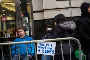New Yorkers wait in line outside a Best Buy for the midnight release of the XBox One in November 2013.