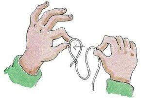 To make a slip knot, slide the yo-yo string through the loop.