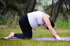 Cat pose stretches the back and shoulders.