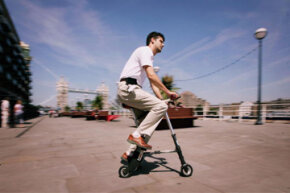 Sinclair Chief Designer Alex Kalogroulis rides the new folding 'A-Bike' on the banks of the Thames in London, England.