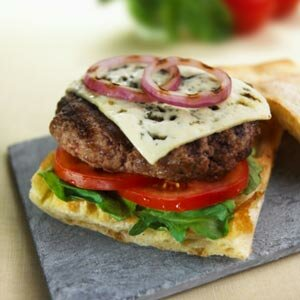 Simply switching up the type of bread you use for a bun can make a cheeseburger into a gourmet meal.